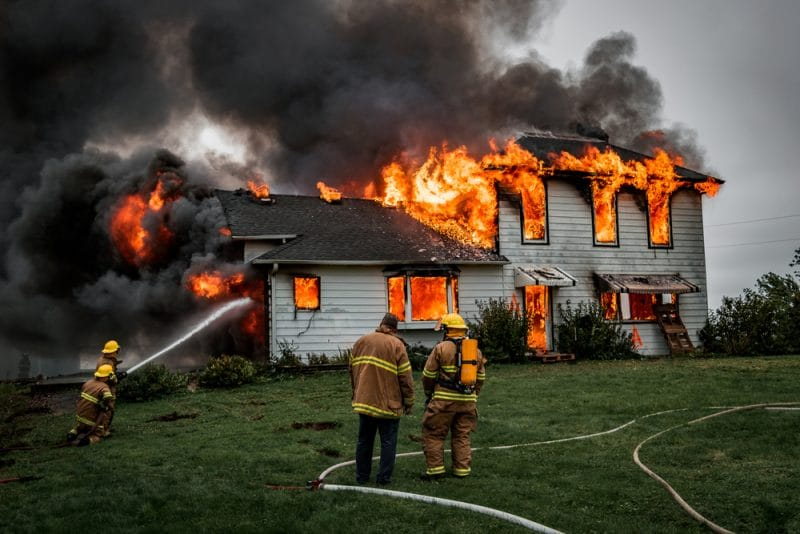 Burning House with Firefighters Working